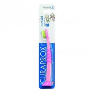 Curaprox Curakid розовая с салатовой щетиной щетка детская с гуммированной ручкой